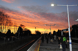 © Licensed to London News Pictures. 09/12/2014 <br /> Commuters at pettswood train station in Kent were greeted with a picturesque sunrise this morning.<br /> A freezing cold morning (09.12.2014) for London commuters at Pettswood train station,Pettswood,Kent.<br /> (Byline:Grant Falvey/LNP)
