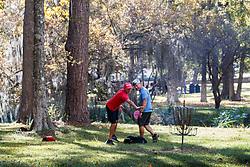 Men playing frisbee golf, Kiwanis Park, Lufkin, Texas, USA.