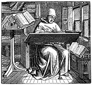 Monk at work on a manuscript in the corner of a scriptorium.  Engraving after 15th century manuscript