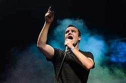 © Licensed to London News Pictures. 08/06/2014. London, UK.   Future Islands performing live at FIeld Day 2014. In this picture - Samuel Herring Future Islands is an american  synthpop band composed of members Gerrit Welmers, William Cashion, Samuel Herring and Michael Lowry.   Photo credit : Richard Isaac/LNP