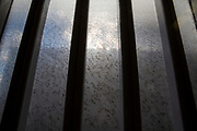 Dirty glass window protected with metal bards in HMP Pentonville, London, UK. HM Prison Pentonville is an English Category B men's prison, operated by Her Majesty's Prison Service. Pentonville Prison is located on  Caledonian Road  (Photo by Andy Aitchison)