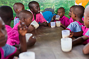 Children from the Wema centre in Mombassa, Kenya enjoy porridge after visiting the Wema Farm. Wema provide a rehabilitation program for street children; poor, disadvantaged youth; and, orphaned and vulnerable children affected by poverty. Emotional support and education enables the children reintegration back into society.