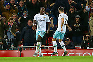 Michail Antonio of West Ham United (l) celebrates with his teammates after scoring his teams 2nd goal. Premier League match, Liverpool v West Ham Utd at the Anfield stadium in Liverpool, Merseyside on Sunday 11th December 2016.<br /> pic by Chris Stading, Andrew Orchard sports photography.
