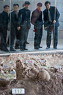 Skeletons at a mass grave site behind glass at the Nanjing Massacre Memorial in Nanjing China.