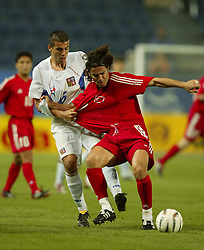 TEPLICE, CZECH REPUBLIC - Wednesday, April 30, 2003: Czech Republic's Milan Baros battles with a Turkey player during a friendly match at the Teplice Stadion Na Stinadlech. (Pic by David Rawcliffe/Propaganda)