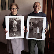 Married couple showing old portraits in Valtuilla de Arriba, Leon province . Spain . The WAY OF SAINT JAMES or CAMINO DE SANTIAGO following the French Route, between Saint Jean Pied de Port and Santiago de Compostela in Galicia, SPAIN. Tradition says that the body and head of St. James, after his execution circa. 44 AD, was taken by boat from Jerusalem to Santiago de Compostela. The Cathedral built to keep the remains has long been regarded as important as Rome and Jerusalem in terms of Christian religious significance, a site worthy to be a pilgrimage destination for over a thousand years. In addition to people undertaking a religious pilgrimage, there are many travellers and hikers who nowadays walk the route for non-religious reasons: travel, sport, or simply the challenge of weeks of walking in a foreign land. In Spain there are many different paths to reach Santiago. The three main ones are the French, the Silver and the Coastal or Northern Way. The pilgrimage was named one of UNESCO's World Heritage Sites in 1993. When there is a Holy Compostellan Year (whenever July 25 falls on a Sunday; the next will be 2010) the Galician government's Xacobeo tourism campaign is unleashed once more. Last Compostellan year was 2004 and the number of pilgrims increased to almost 200.000 people.