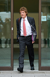 © London News Pictures. 29/05/2013. London, UK. HMRC press officer Jonathan Hall leaving Westminster Magistrates court where he faces charges of conspiracy to commit misconduct in public office over allegations he and his partner Marta Bukarewicz received payments from The Sun newspaper of £17,475 in exchange for unauthorised disclosure of information.  Photo credit: Ben Cawthra/LNP