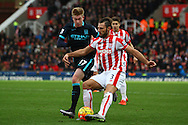 Eric Pieters of Stoke City (r) passes the ball under pressure from Kevin De Bruyne of Manchester City. Barclays Premier league match, Stoke city v Manchester city at the Britannia Stadium in Stoke on Trent, Staffs on Saturday 5th December 2015.<br /> pic by Chris Stading, Andrew Orchard sports photography.
