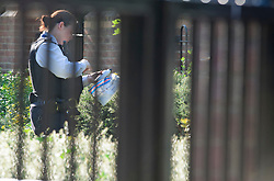 ©Licensed to London News Pictures 14/09/2020  <br /> Bromley, UK. A police officer with an evidence bag. Police have cordoned off Bromley College in Bromley, South East London after reports of a stabbing outside. credit:Grant Falvey/LNP