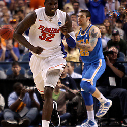 Mar 19, 2011; Tampa, FL, USA; Florida Gators center Vernon Macklin (32) reacts after a score during second half of the third round of the 2011 NCAA men's basketball tournament against the UCLA Bruins at the St. Pete Times Forum. Florida defeated UCLA 73-65.  Mandatory Credit: Derick E. Hingle