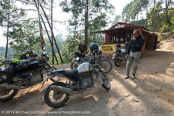 Round the World Doug Wothke at a mountainside chai stop on Motorcycle Sherpa's Ride to the Heavens motorcycle adventure in the Himalayas of Nepal. Riding from Chitwan to Daman. Tuesday, November 12, 2019. Photography ©2019 Michael Lichter.