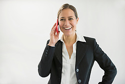 Businesswoman in black suit talking on smart phone, smiling