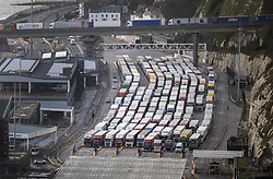 FILE IMAGE FOR COMBINATION © Licensed to London News Pictures. 21/12/2020. Dover, UK. File image from 18/12/2020 shows trucks queuing up in the customs lanes at The Port of Dover. France is among a number of countries to ban travel from the UK as Covid-19 infections rise dramatically and the possibility of a new mutant strain. Photo credit: Peter Macdiarmid/LNP