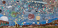 whimsical planetarium and space wall mural on a wall in Goldendale, Washington, USA