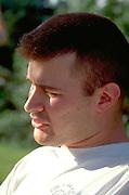 Man age 25 looking thoughtfully into distance.  Shakopee  Minnesota USA