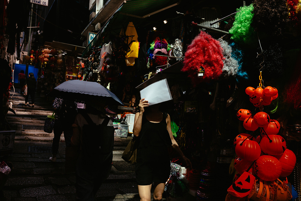 People walk down a section of Pottinger Street, in Central, Hong Kong Island, on October 15, 2019. The famous Pottinger Street was named in 1858 after Henry Pottinger, the first Governor of Hong Kong, serving from 1843 to 1844.