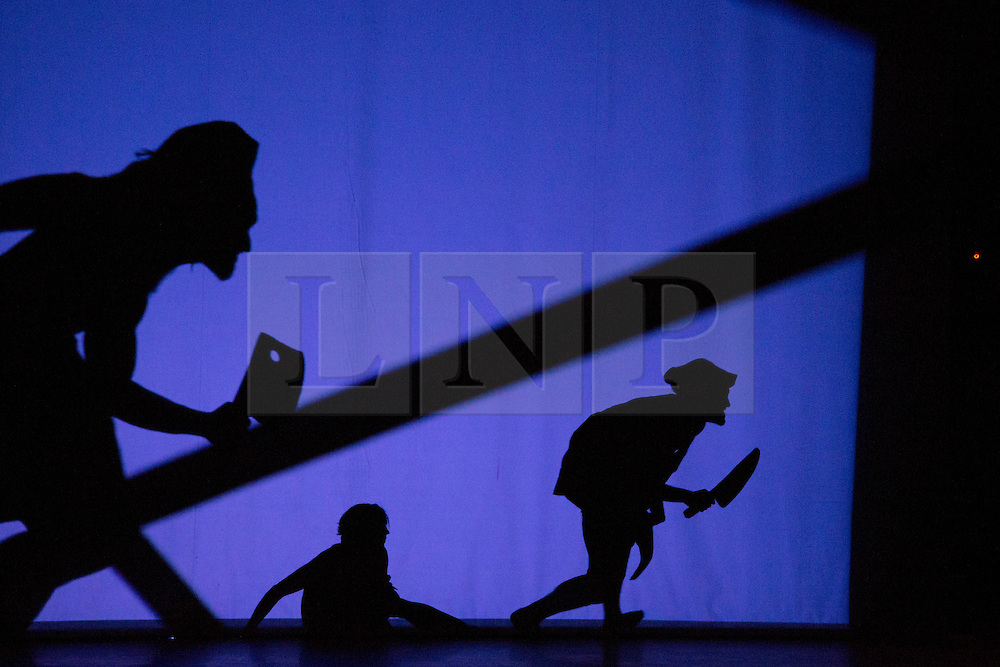"""© Licensed to London News Pictures. 12 March 2014. London, England. Pictured: Scene """"Chefs"""". Pilobolus dance troupe presents """"Shadowland"""", a show part dance, part circus, part concert utilising multiple moving screens. """"Shadowland"""" is performed for the first time in the UK. Created in collaboration with Steven Banks and featuring a score by David Poe, the show will run from 11 March to 30 March 2014 at the Peacock Theatre, London. Photo credit: Bettina Strenske/LNP"""