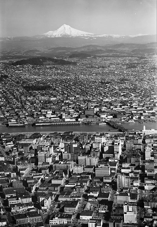 ackroyd 02104-8. downtown looking east, Mt. Hood. March 29, 1950