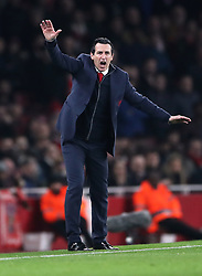 Arsenal manager Unai Emery instructs his players during the UEFA Europa League round of 32 second leg match at the Emirates Stadium, London.