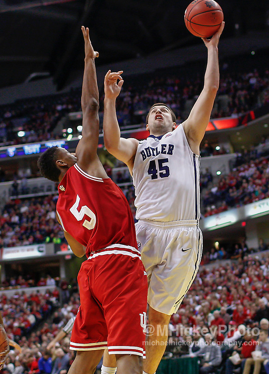 INDIANAPOLIS, IN - DECEMBER  20: Andrew Chrabascz #45 of the Butler Bulldogs shoots the ball against Troy Williams #5 of the Indiana Hoosiers at Bankers Life Fieldhouse on December 20, 2014 in Indianapolis, Indiana. Indiana defeated Butler 82-73. (Photo by Michael Hickey/Getty Images) *** Local Caption *** Andrew Chrabascz; Troy Williams