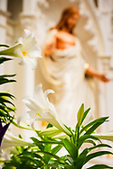 Easter lilies and the reredos with the statue depicting Jesus Christ on Monday, April 5, 2021, at Immanuel Lutheran Church, Washington, Mo. LCMS Communications/Erik M. Lunsford