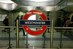 © Licensed to London News Pictures. 08/01/2013, London, UK. Passengers walk by an underground sign at Westminster underground station in London, Tuesday, Jan. 8, 2013. London Underground mark its 150 year anniversary on 9 January. In 1863 January 9 the world first underground train entered into public service. Photo credit : Sang Tan/LNP
