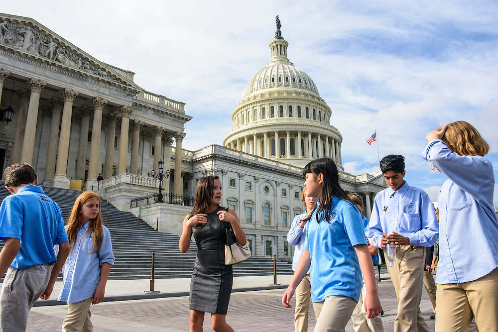 Washington, D.C. - October 07, 2016: En Route to their third and final meeting of the day, Andrea Delgado, Earthjustice lobbyist, coaches members of the Hyperbolics on presentation strategies as they walk past the U.S. Capital Building. <br /> <br /> The Hyperbolics are a First Lego League team based out of Sterling School in Greenville SC, who made a trip to DC ask government officials to ban lead wheel weights Friday October 7, 2016.<br /> <br /> <br /> CREDIT: Matt Roth for Earthjustice