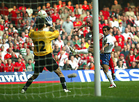 Photo: Scott Heavey<br />Wales V Azerbaijan. 29/03/03.<br />John Hartson strikes to make it 3-0 during this afternoons Euro 2004 Group 9 qualifying match at the Millenium stadium in Cardiff.