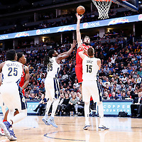 01 November 2017: Toronto Raptors center Jonas Valanciunas (17) goes for the baby hook over Denver Nuggets center Nikola Jokic (15) and Denver Nuggets forward Kenneth Faried (35) during the Denver Nuggets 129-111 victory over the Toronto Raptors, at the Pepsi Center, Denver, Colorado, USA.