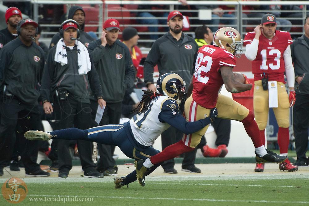 January 3, 2016; Santa Clara, CA, USA; San Francisco 49ers wide receiver Torrey Smith (82) runs against St. Louis Rams cornerback Janoris Jenkins (21) during the fourth quarter at Levi's Stadium. The 49ers defeated the Rams 19-16.