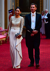 Foreign Secretary Jeremy Hunt and his wife Lucia arrive at the State Banquet at Buckingham Palace, London, on day one of US President Donald Trump's three day state visit to the UK.