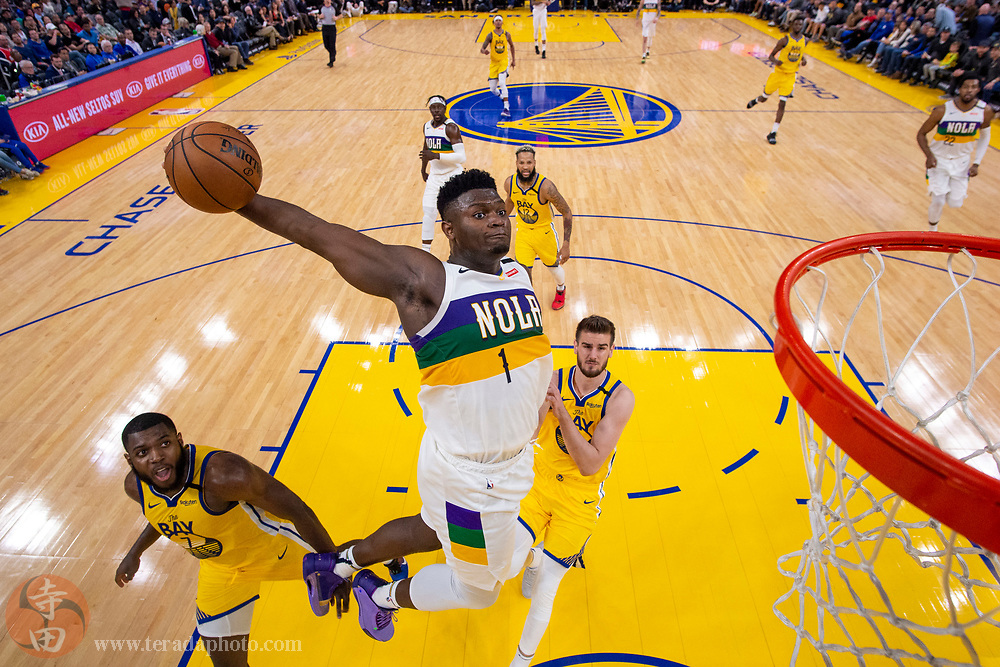 February 23, 2020; San Francisco, California, USA; New Orleans Pelicans forward ZionWilliamson (1) dunks the basketball against Golden State Warriors forward Eric Paschall (7) and center Dragan Bender (10) during the second half at Chase Center.