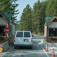 A car stops at an entrance station to Banff National Park in Alberta, Canada.