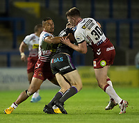 Rugby League - 2020 Super League - Round 13 - Wigan Warriors vs Wakefield Trinity<br /> <br /> Wakefield Trinity's Tom Johnstone is tackled, at the Halliwell Jones Stadium, Warrington<br /> <br /> COLORSPORT/TERRY DONNELLY