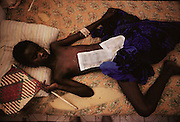 """A young shelling victim in a """"Villa Hospital"""", a private home turned into a hospital in the north sector (Ali Mahdi controlled sector), in Mogadishu, war-torn capital of Somalia where 30,000 died between November 1991 and March 1992. March 1992."""