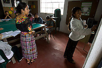 Nirma Angélica Calel Aean (left) teaches young laborers, who work for local vegetable and fruit exporters, textile plants and private homes, primary school subjects at the Centro de Estudios Apoyo al Desarrollo Local in Chimaltenango, Guatemala on Sunday, March 11, 2007. The workers' long hours keep them from studying much during the week.