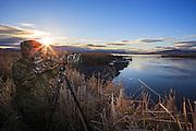 Photographer photgraphing birds on Lake Helena Wildlife Management Area, Montana.