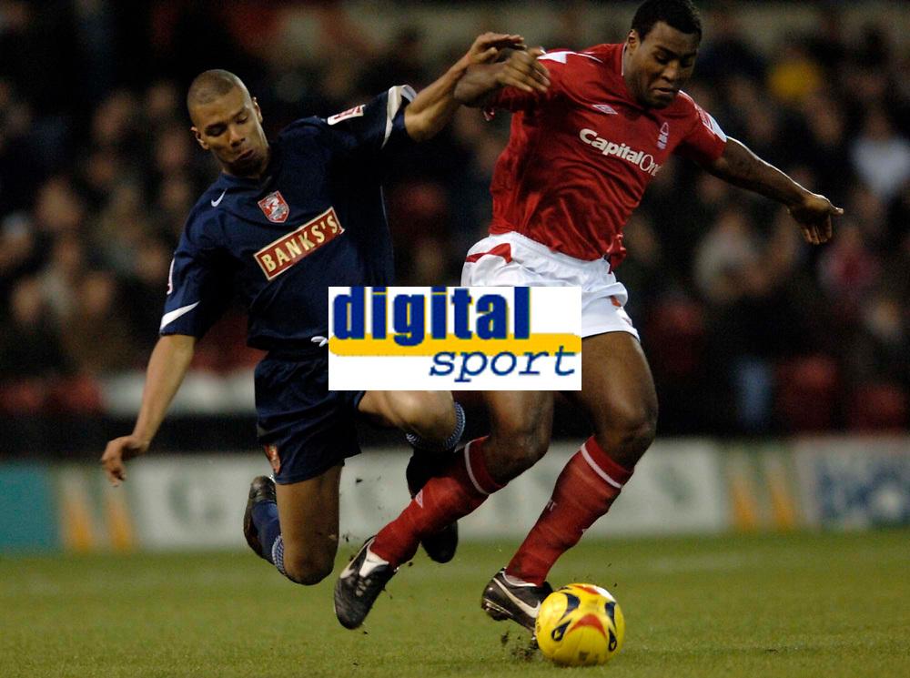Photo: Glyn Thomas.<br />Nottingham Forest v Walsall. Coca Cola League 1.<br />10/12/2005.<br />Nottingham Forest's Wes Morgan (R) brushes aside a challenge from Julian Bennett.
