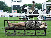 © Licensed to London News Pictures. 15/05/2014. Windsor, UK. A woman rests on a bench. The second day of The Royal Windsor Horse Show, set in the grounds of Windsor Castle. Established in 1943. Photo credit : Stephen Simpson/LNP