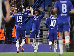 Willian ( 2nd L )  of Chelsea celebrates after scoring to make it 2-0 - Mandatory byline: Paul Terry/JMP - 09/12/2015 - Football - Stamford Bridge - London, England - Chelsea v FC Porto - Champions League - Group G
