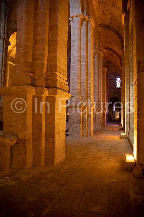 Abbey Church columns at Fontfroide Abbey near Narbonne, France. Fontfroide Abbey is a former Cistercian monastery in France, situated 15 kilometers south-west of Narbonne. It was founded in 1093 by Aimery I, Viscount of Narbonne, but remained poor and obscure, and needed to be refounded by Ermengarde, Viscountess of Narbonne. The abbey fought together with Pope Innocent III against the heretical doctrine of the Cathars who lived in the region. It was dissolved in 1791 in the course of the French Revolution. The premises, which are of very great architectural interest, passed into private hands in 1908, when the artists Gustave and Madeleine Fayet dAndoque bought it to protect the fabric of the buildings from an American collector of sculpture. They restored it over a number of years and used it as a centre for artistic projects. It still remains in private hands. Today it is open to paying guests.