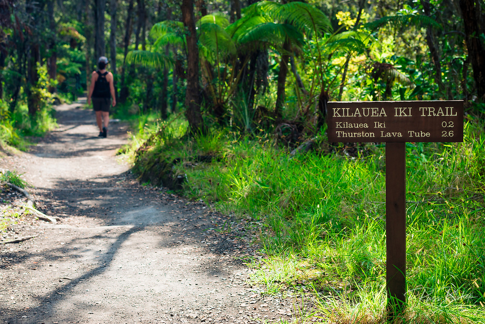 Hiker and sign on the Kilauea Iki trail, Hawaii Volcanoes National Park, Hawaii USA