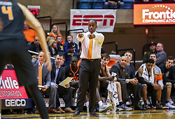 Jan 12, 2019; Morgantown, WV, USA; Oklahoma State Cowboys head coach Mike Boynton calls out a play from the bench during the second half against the West Virginia Mountaineers at WVU Coliseum. Mandatory Credit: Ben Queen-USA TODAY Sports