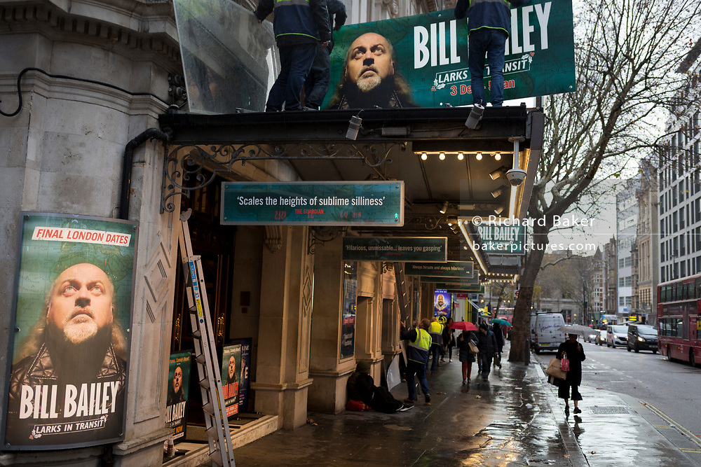 Theatre hoardings for the West End production of comedian Bill Bailey's Christmas performances, 'Larks in Transit' are mounted outside Wyndham's Theatre, on 3rd December 2018, in London, UK