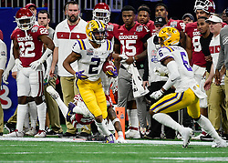 LSU Tigers wide receiver Justin Jefferson (2) carries the ball during the first half against Oklahoma Sooners in the 2019 College Football Playoff Semifinal at the Chick-fil-A Peach Bowl on Saturday, Dec. 28, in Atlanta. (Vasha Hunt via Abell Images for the Chick-fil-A Peach Bowl)