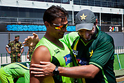 Pakistan National Cricket captain Shahid Afridi hugs fellow team mate Shoaib Akhtar as the latter announces his retirement from international cricket during the  2011 ICC World Cricket Cup Premadasa Stadium, Colombo, Sri Lanka.