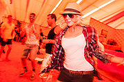 Dancing at lunchtime in the orange tent of the Beat Hotel. The 2013 Glastonbury Festival, Worthy Farm, Glastonbury. 30 June 2013. © Guy Bell, guy@gbphotos.com, all rights reserved