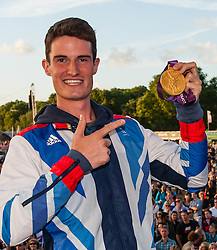 © Licensed to London News Pictures. 03/08/2012. London, UK. Team GB gold medal winning Olympic Shooting athlete Peter Wilson at BT London Live, Hyde Park.  Peter yesterday won Britain's fourth gold medal in the Double Trap competition.  Peter is a 25 year old former barman.  Here he proudly displays his medal and meets fans.  . Photo credit : Richard Isaac/LNP