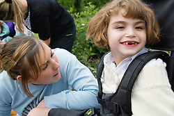 Child with brain damage and her carer,