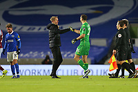 Football - 2020 / 2021 Premier League - Brighton and Hove Albion vs. Aston Villa - Amex Stadium<br /> <br /> Brighton Head Coach Graham Potter gives a fist bump to Emiliano Martinez of Aston Villa after the Villa keeper made some fine saves to keep the score nil nil at The Amex Stadium Brighton <br /> <br /> COLORSPORT/SHAUN BOGGUST